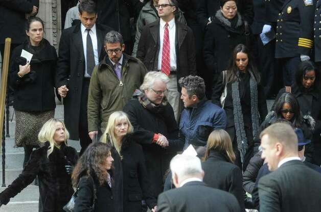 Philip Seymour Hoffman and fellow mourners exit the church after the funeral for the three Badger sisters, Lilian, Sarah and Grace, takes place at St. Thomas Church Fifth Avenue in Manhattan, N.Y., on Thursday, January 5, 2012. The sisters were killed along with their grandparents, Lomer and Pauline Johnson, when their mother's Shippan home burned down on Christmas Day. Photo: Keelin Daly / Stamford Advocate
