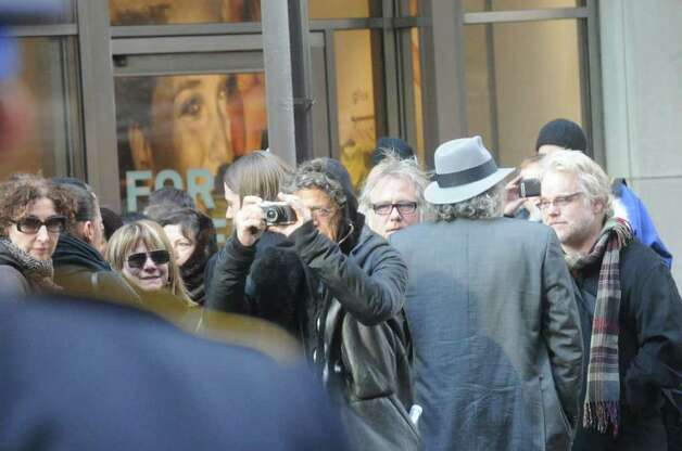 Lou Reed takes a photo of the procession after the funeral for the three Badger sisters, Lilian, Sarah and Grace, takes place at St. Thomas Church Fifth Avenue in Manhattan, N.Y., on Thursday, January 5, 2012. The sisters were killed along with their grandparents, Lomer and Pauline Johnson, when their mother's Shippan home burned down on Christmas Day. Photo: Keelin Daly / Stamford Advocate
