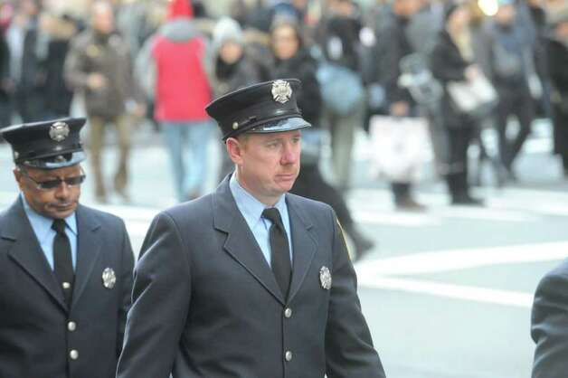 Stamford firefighters take part in the funeral services for the three Badger sisters, Lilian, Sarah and Grace, takes place at St. Thomas Church Fifth Avenue in Manhattan, N.Y., on Thursday, January 5, 2012. The sisters were killed along with their grandparents, Lomer and Pauline Johnson, when their mother's Shippan home burned down on Christmas Day. Photo: Keelin Daly / Stamford Advocate