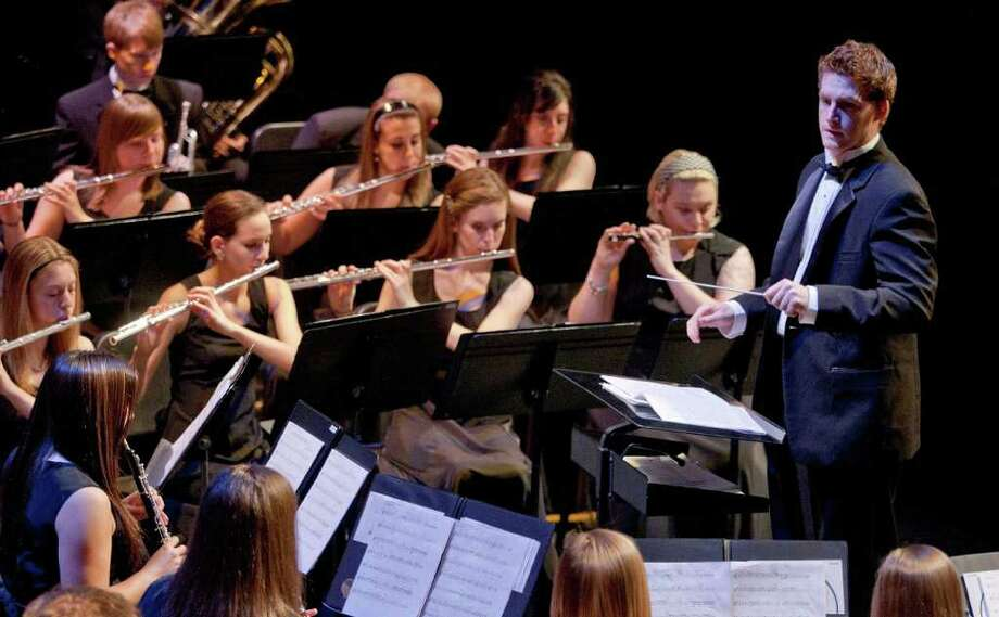 Senior Brian Beatty, right, conducts the Sacred Heart University Concert Band, which will perform in Ireland next week. Photo: Contributed Photo