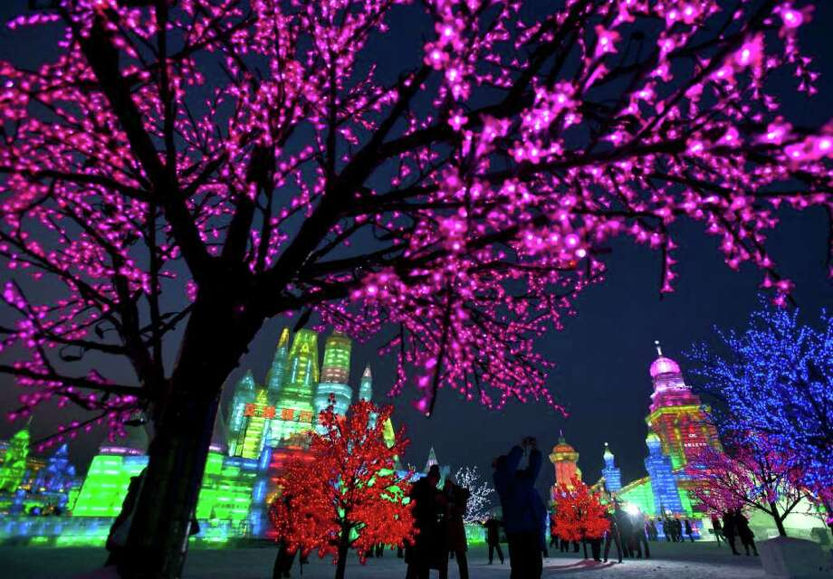 Visitors enjoy the sights at the Harbin International Ice and Snow festival in Harbin in northeastern's China's Heilongjiang province, Thursday, Jan. 5, 2012. Photo: Andy Wong, Associated Press / AP