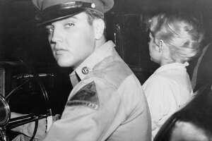 Pvt. Elvis Presley, accompanied by his girlfriend Anita Wood, prepared to drive from his home in Killeen, Texas to join his Army outfit at Ft. Hood, Texas late Friday night, September 21, 1958. The rock 'n roll singer is being transferred to Germany. Anita, who had been crying, refused to face the camera because she said she was red-eyed. (AP Photo)