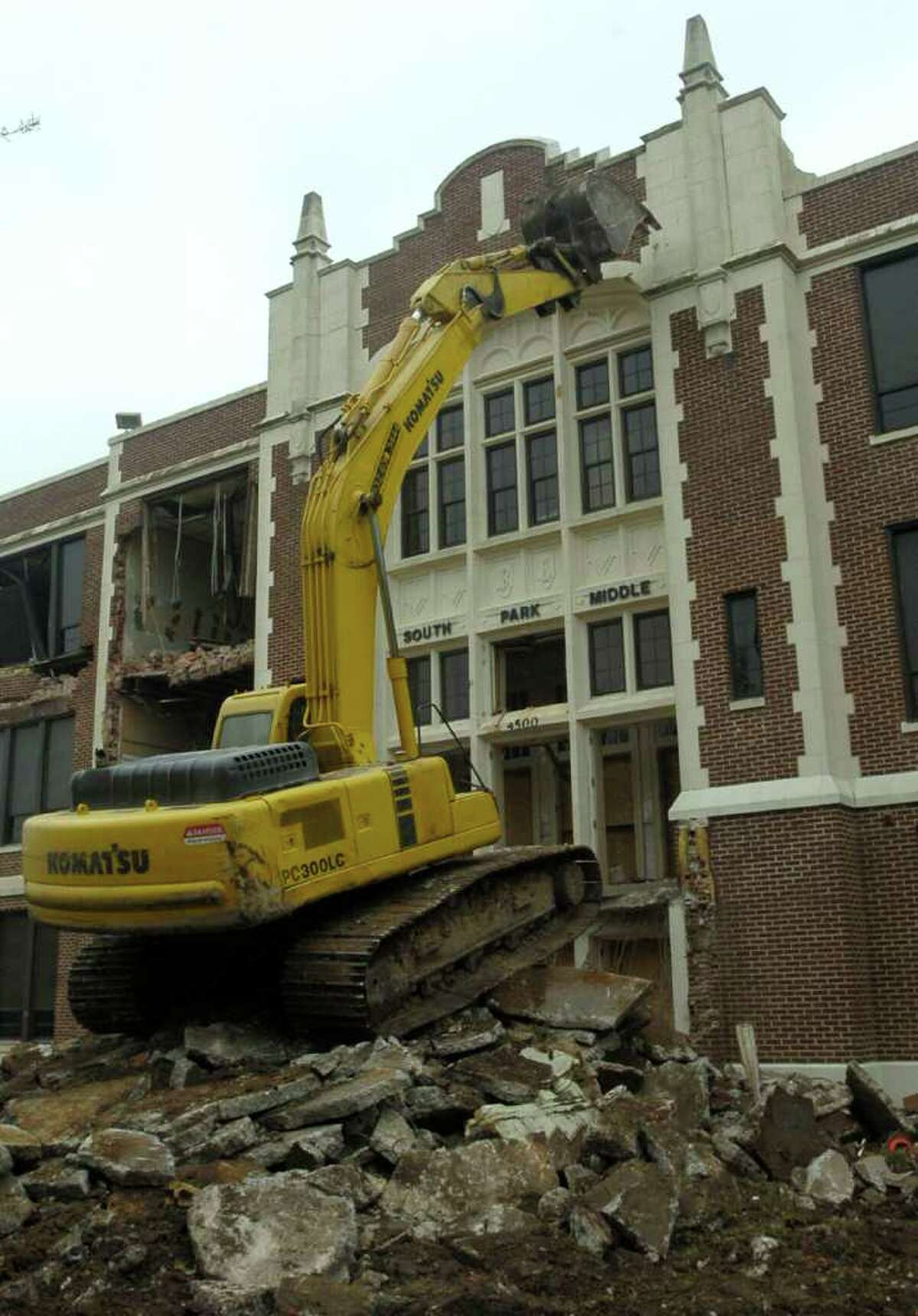 The Ambush Demolition excavator lines up to the front facade of the South Park Middle School as demolition began in April, 2010. Dave Ryan/The Enterprise