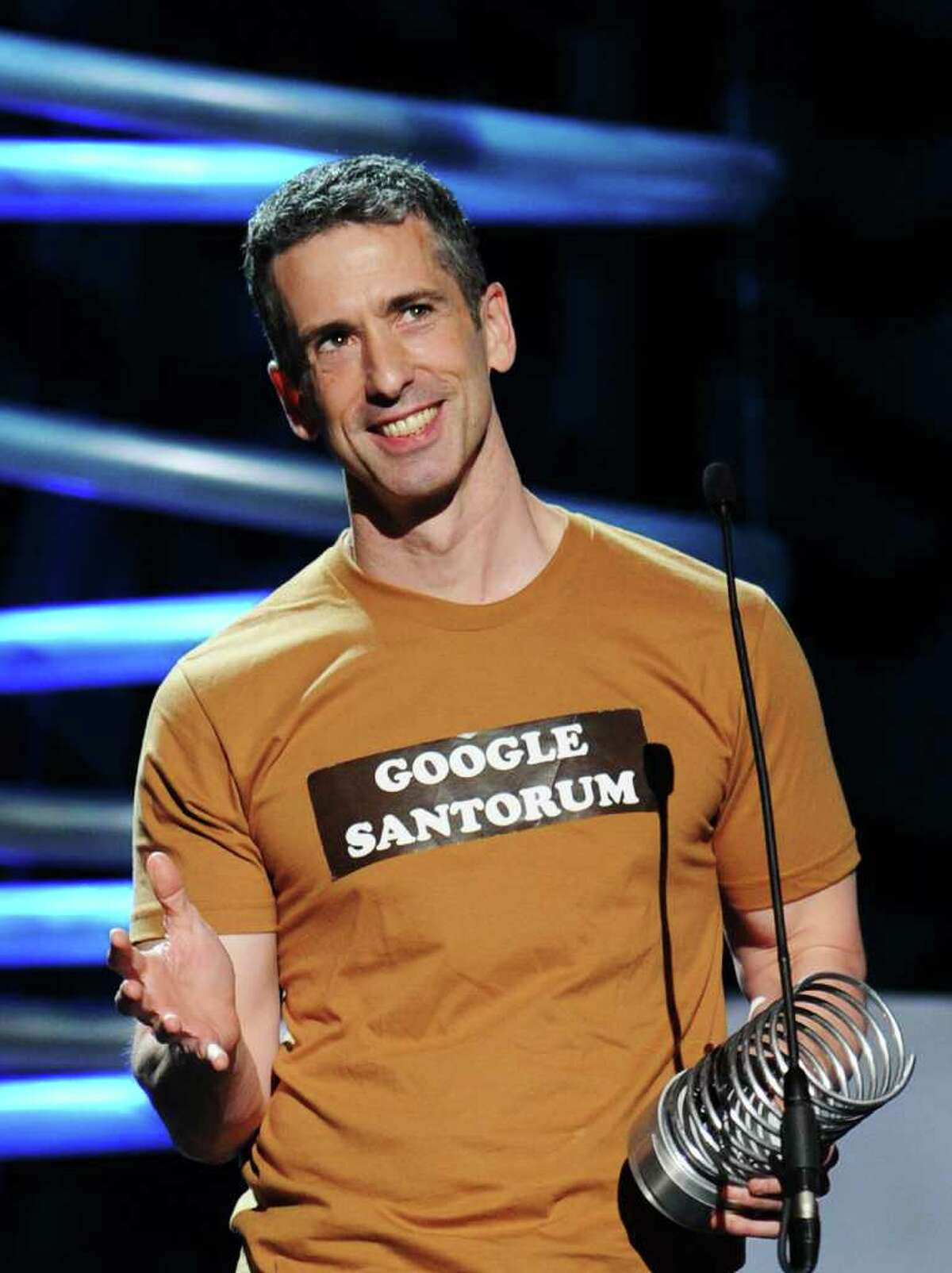 Dan Savage speaks onstage during the 15th Annual Webby Awards at Hammerstein Ballroom on June 13, 2011 in New York City.
