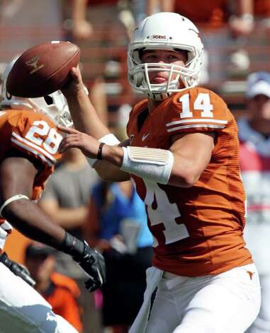 FOR SPORTS - Texas' David Ash looks to pass against Oklahoma State during first half action Saturday Oct. 15, 2011at Texas Memorial Stadium in Austin, Tx.  (PHOTO BY EDWARD A. ORNELAS/eaornelas@express-news.net) Photo: EDWARD A. ORNELAS, SAN ANTONIO EXPRESS-NEWS / © SAN ANTONIO EXPRESS-NEWS (NFS)