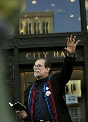 Reverend Kurt A. Kuhwald, speaks to members of Occupy Oakland and Interfaith Tent as they gather on the steps of Oakland City Hall on Thursday Jan. 5, 2012. They were upset after Interfaith Tent at Oakland was taken down by Oakland Police late last night, and wanted to voice their concerns to Oakland Mayor Jean Quan. as members of occupy Oakland and Interfaith Tent at Oakland try to enter Oakland City Hall on Thursday Jan. 5, 2012. They were upset after Interfaith tent at Oaklnd was taken down by Oakland Police late last night, and wanted to voice their concerns to Oakland Mayor Jean Quan. Photo: Michael Macor, The Chronicle