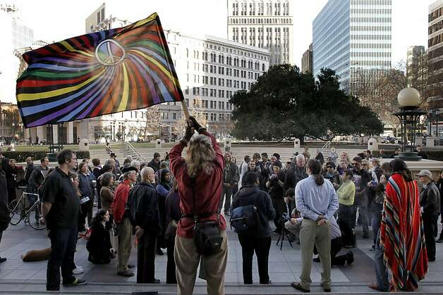 Members of Occupy Oakland and Interfaith Tent at Oakland, hold a small rally as they gather on the steps of Oakland City Hall on Thursday Jan. 5, 2012. They were upset after Interfaith Tent at Oakland was removed by Oakland Police late last night, and they wanted to voice their concerns to Oakland Mayor Jean Quan. Photo: Michael Macor, The Chronicle