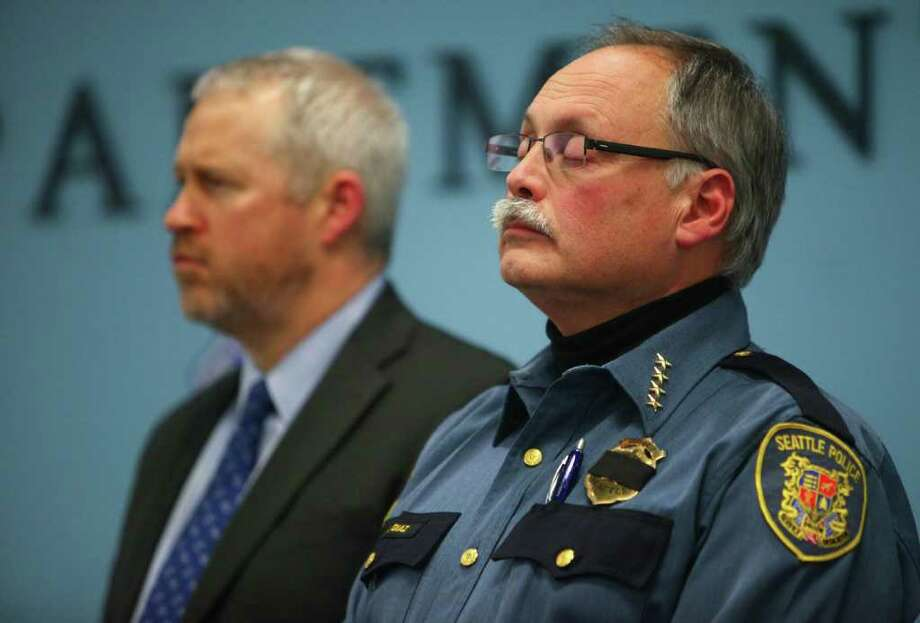 Seattle Mayor Mike McGinn and Police Chief John Diaz speak to reporters after announcing that Officer Richard Francis Nelson died from a self-inflicted gunshot wound after the veteran officer was arrested for mishandling drug evidence on Thursday, January 5, 2011. Photo: JOSHUA TRUJILLO / SEATTLEPI.COM
