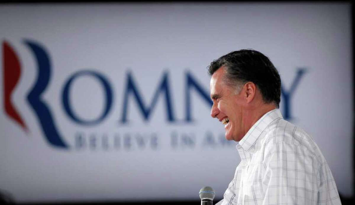 Republican presidential candidate former Massachusetts Gov. Mitt Romney smiles while campaigning at a Boys and Girls Club, Thursday, Jan. 5, 2012, in Salem, N.H. (AP Photo/Matt Rourke)