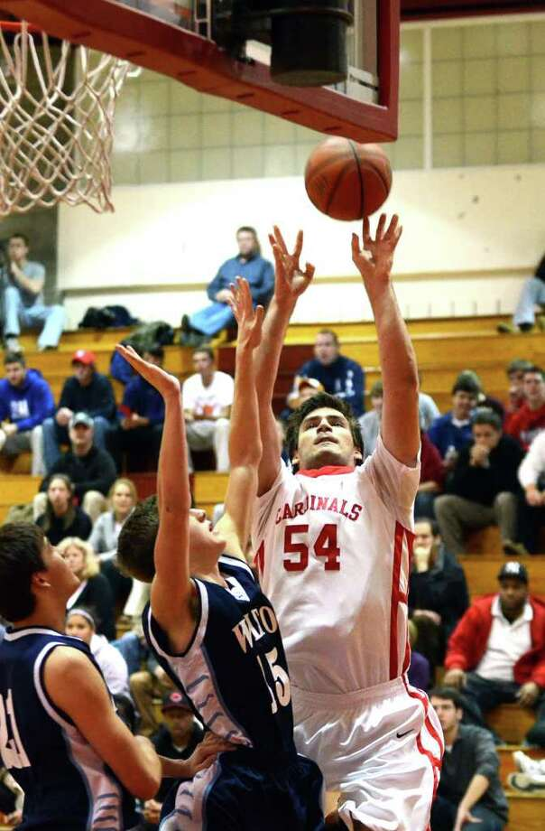 Greenwich's Greg Donlic (54) shoots over Wilton's Will Kelley (15) during the boys basketball game at Greenwich on Thursday, Jan. 5, 2012. Photo: Amy Mortensen / Connecticut Post Freelance