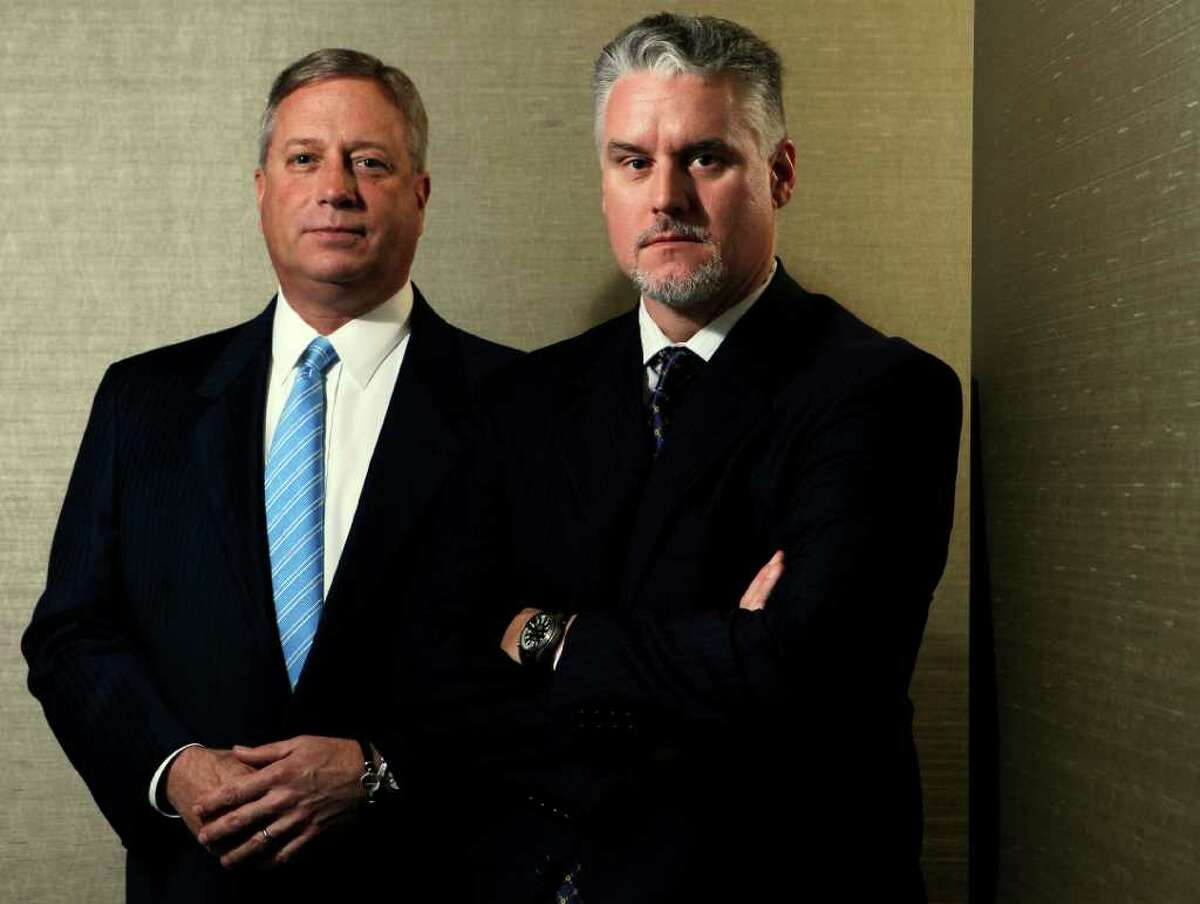 Former Stanford Financial Group brokers Charles Rawl, left, and Mark Tidwell say SEC attorneys promised them legal protection, but the receiver appointed to recover assets in the case sued both of them for hundreds of thousands of dollars.