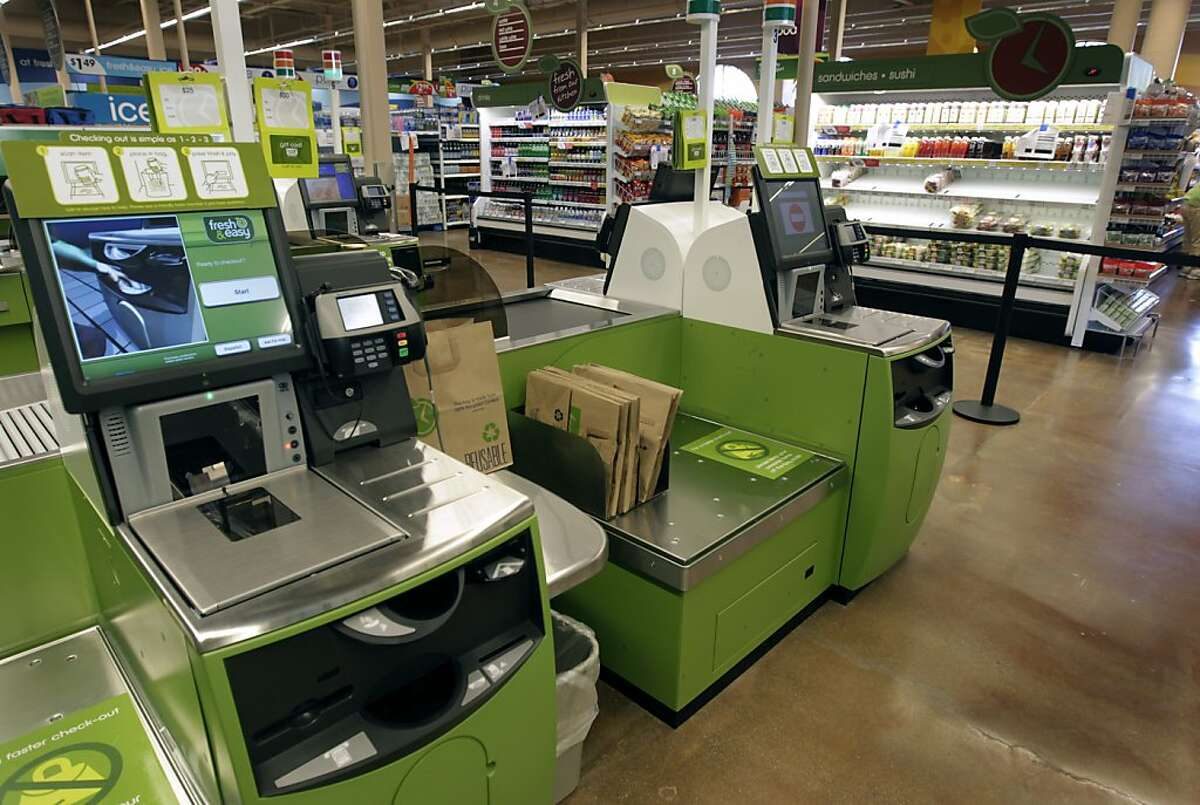 Checkout lanes are ready to go at the new Fresh & Easy grocery store in San Francisco, Calif. on Tuesday, June 21, 2011. The new market, opening Wednesday, features self-serve checkout aisles but will also has staff standing by to assist shoppers.