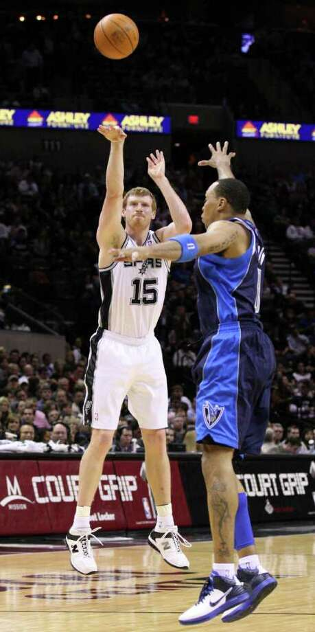 San Antonio Spurs forward Matt Bonner (15) shoots against Dallas Mavericks forward Shawn Marion (0) during first half action Thursday Jan. 5, 2012 at the AT&T Center. Photo: EDWARD A. ORNELAS, Express-News / SAN ANTONIO EXPRESS-NEWS (NFS)