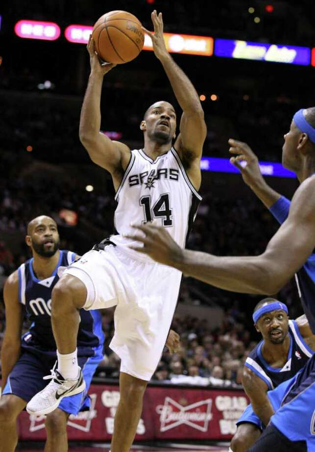 San Antonio Spurs guard Gary Neal (14) shoots against Dallas Mavericks center Brendan Haywood, right,  during first half action Thursday Jan. 5, 2012 at the AT&T Center. Photo: EDWARD A. ORNELAS, Express-News / SAN ANTONIO EXPRESS-NEWS (NFS)