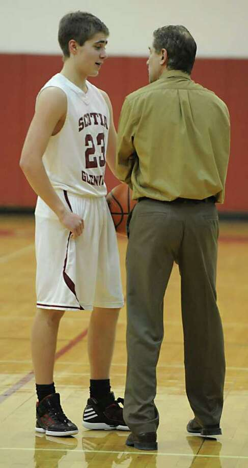 Scotia's Alex Sausville talks to his dad and Scotia's assistant coach Mark Sausville during a basketball game against Glens Falls Thursday, Jan 5, 2012 in Scotia N.Y.  (Lori Van Buren / Times Union) Photo: Lori Van Buren