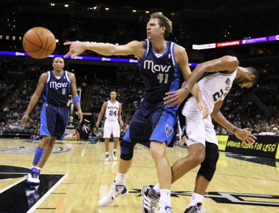 Dallas Mavericks forward Dirk Nowitzki (41) passes near San Antonio Spurs forward Tim Duncan (21) during second half action Thursday Jan. 5, 2012 at the AT&T Center. Photo: EDWARD A. ORNELAS, Express-News / SAN ANTONIO EXPRESS-NEWS (NFS)