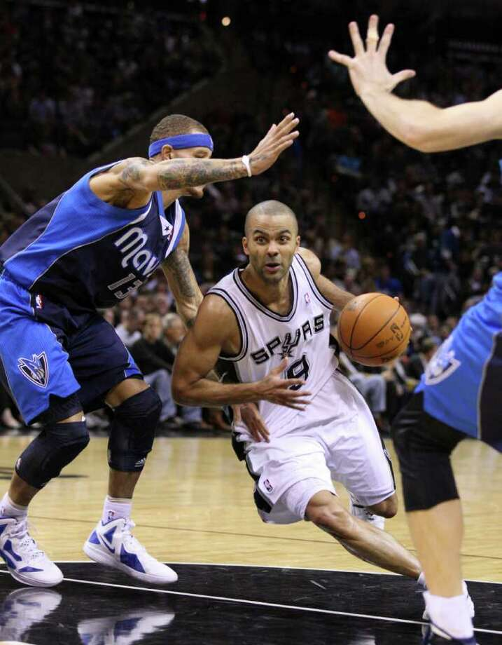 San Antonio Spurs guard Tony Parker (9) drives around Dallas Mavericks guard Delonte West (13) during second half action Thursday Jan. 5, 2012 at the AT&T Center. Photo: EDWARD A. ORNELAS, Express-News / SAN ANTONIO EXPRESS-NEWS (NFS)