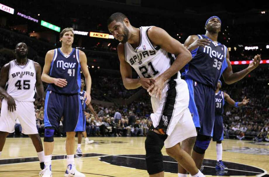 San Antonio Spurs forward Tim Duncan (21) reacts after drawing contact from Dallas Mavericks center Brendan Haywood (33) during second half action Thursday Jan. 5, 2012 at the AT&T Center. Photo: EDWARD A. ORNELAS, Express-News / SAN ANTONIO EXPRESS-NEWS (NFS)