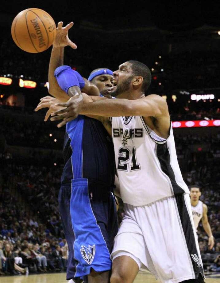 San Antonio Spurs forward Tim Duncan (21) draws contact from Dallas Mavericks center Brendan Haywood (33) during second half action Thursday Jan. 5, 2012 at the AT&T Center. Photo: EDWARD A. ORNELAS, Express-News / SAN ANTONIO EXPRESS-NEWS (NFS)