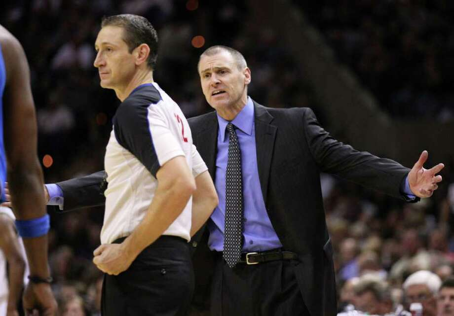 Dallas Mavericks head coach Rick Carlisle makes his case with official JT Orr during second half action Thursday Jan. 5, 2012 at the AT&T Center. Photo: EDWARD A. ORNELAS, Express-News / SAN ANTONIO EXPRESS-NEWS (NFS)