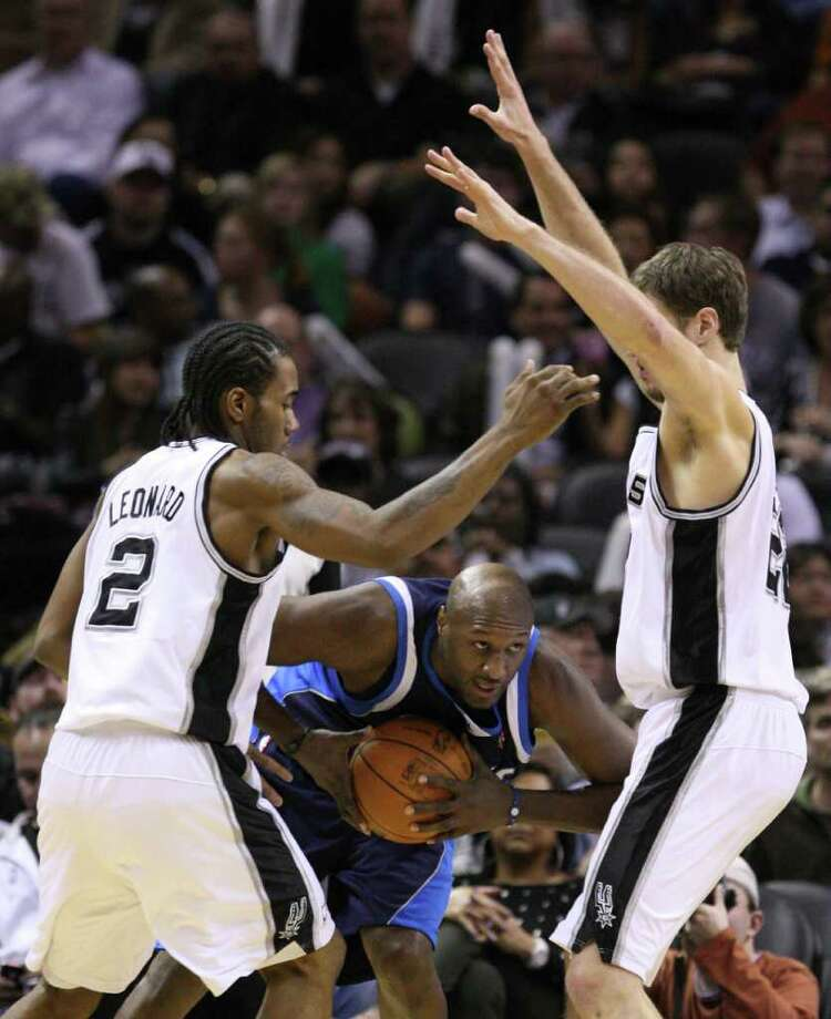 Dallas Mavericks forward Lamar Odom (7) is pressured by San Antonio Spurs forward Kawhi Leonard (2) and San Antonio Spurs forward Tiago Splitter (22) during second half action Thursday Jan. 5, 2012 at the AT&T Center. Photo: EDWARD A. ORNELAS, Express-News / SAN ANTONIO EXPRESS-NEWS (NFS)