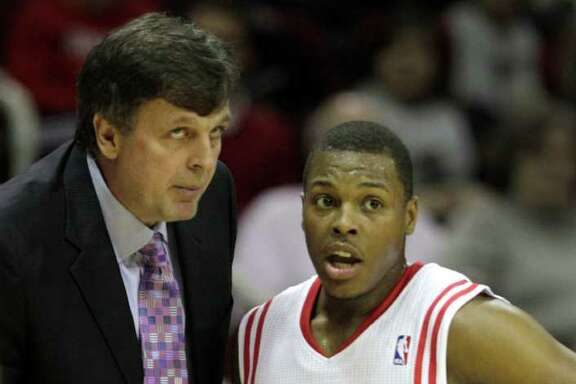 Houston Rockets head coach Kevin McHale, left, talks to Rockets point guard Kyle Lowry (7) during the first half of a pre-season NBA basketball game against the San Antonio Spurs at Toyota Center Saturday, Dec. 17, 2011, in Houston. ( Brett Coomer / Houston Chronicle )