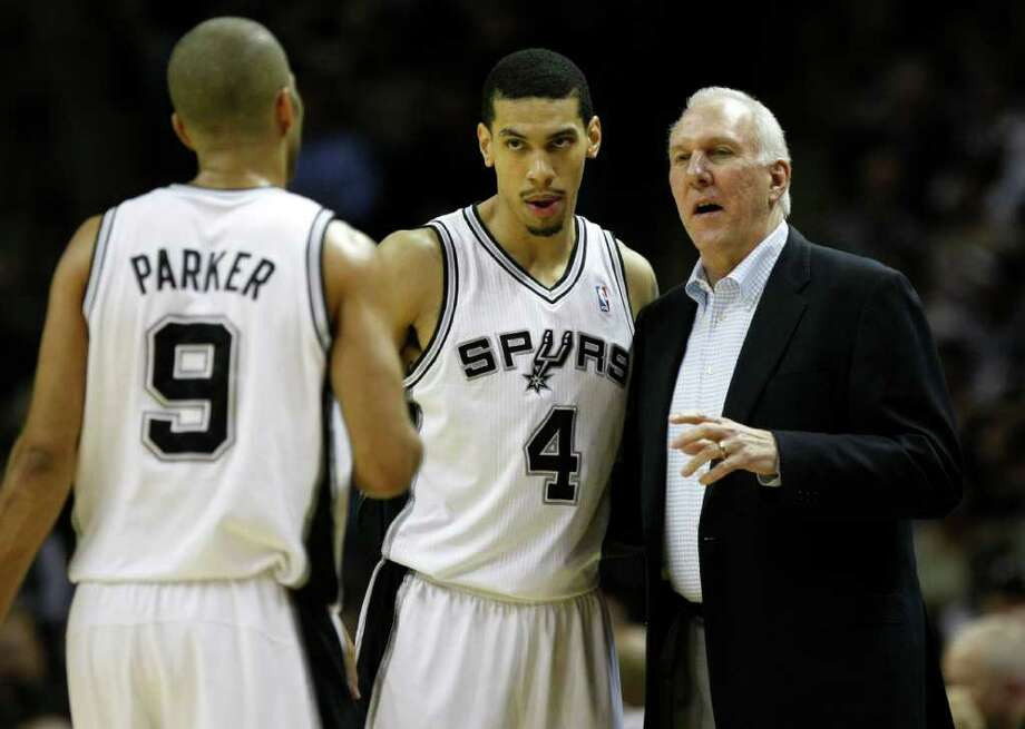 San Antonio Spurs head coach Gregg Popovich talks with San Antonio Spurs guard Tony Parker (9) and San Antonio Spurs guard Danny Green (4) during first half action Thursday Jan. 5, 2012 at the AT&T Center. Photo: KEVIN MARTIN, Express-News / SAN ANTONIO EXPRESS-NEWS (NFS)