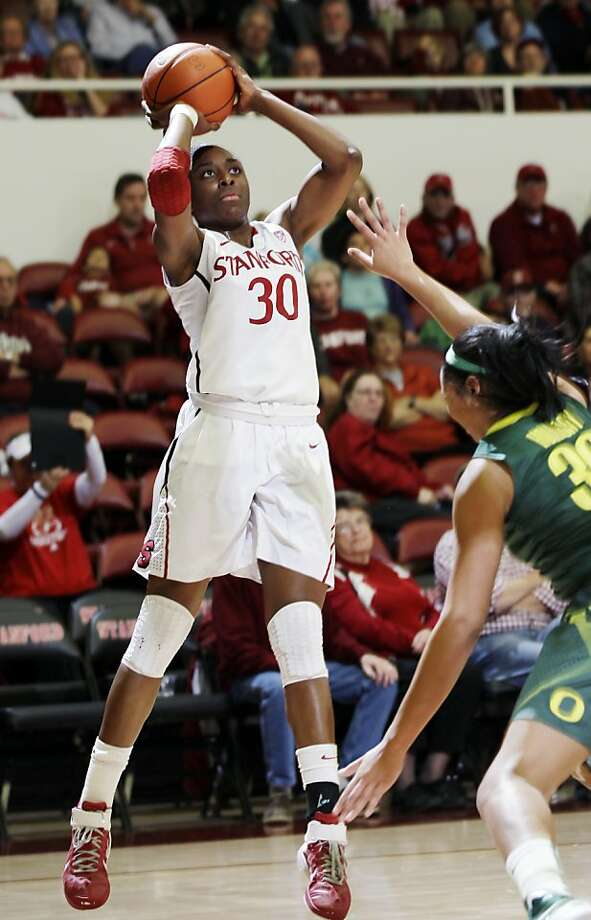 Stanford forward Nnemkadi Ogwumike (30) scores against Oregon guard Jasmin Holliday (30) in the first half of an NCAA college basketball game in Stanford, Calif., Thursday, Jan. 5, 2012. (AP Photo/Paul Sakuma) Photo: Paul Sakuma, Associated Press