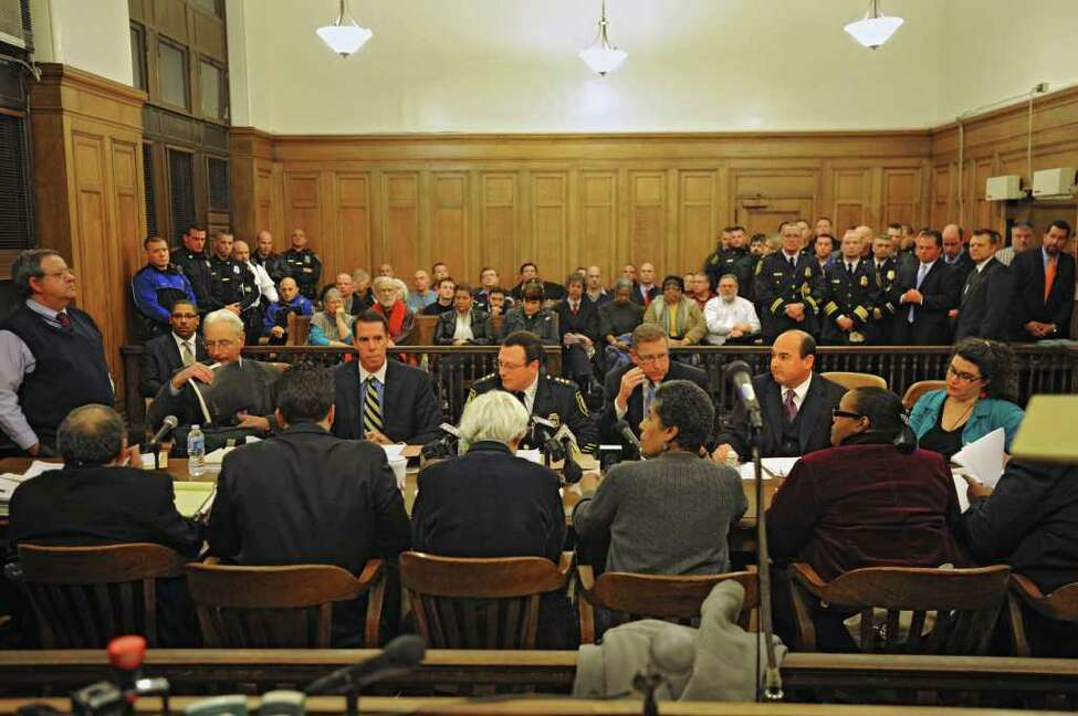 A crowd with the mix of police officers and members of Occupy Albany pack a court room to hear Police Chief Steve Krokoff answer questions from the Albany?s Common Council over the handling of the Occupy Albany raid Thursday, Jan 5, 2012 in Albany N.Y. (Lori Van Buren / Times Union)