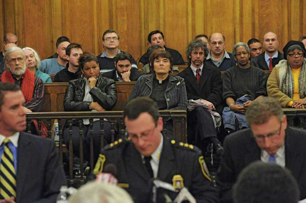 A crowd with the mix of police officers and members of Occupy Albany pack a court room to hear Police Chief Steve Krokoff, center, answer questions from the Albany?s Common Council over the handling of the Occupy Albany raid Thursday, Jan 5, 2012 in Albany N.Y. (Lori Van Buren / Times Union)