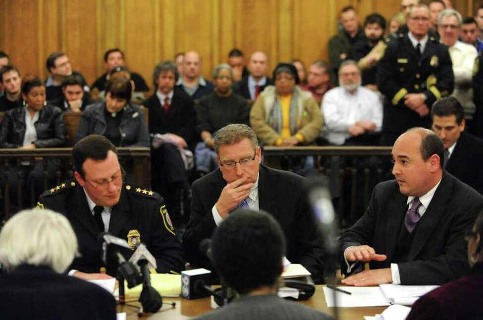 Assistant Corporation Counsel Jeffrey Jamison, right, speaks after Police Chief Steve Krokoff, left, spoke to the Albany?s Common Council over the handling of the Occupy Albany raid Thursday, Jan 5, 2012 in Albany N.Y. (Lori Van Buren / Times Union)