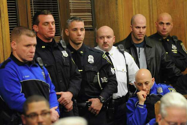 Police officers listen to Police Chief Steve Krokoff answer questions from the Albany?s Common Council over the handling of the Occupy Albany raid Thursday, Jan 5, 2012 in Albany N.Y.  (Lori Van Buren / Times Union) Photo: Lori Van Buren
