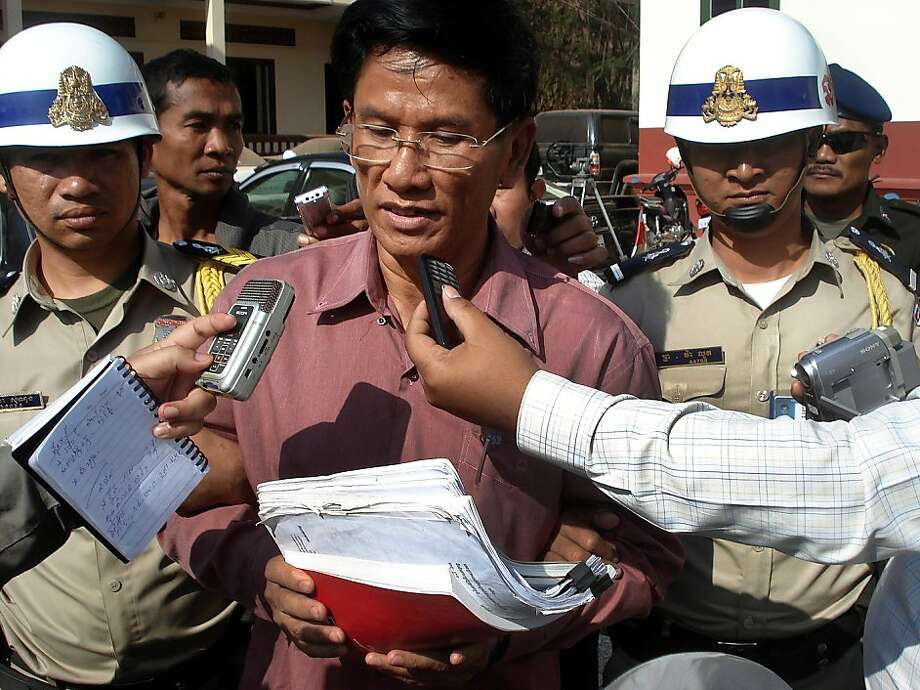 Former Cambodian head the National Authority for Combating Drugs Moek Dara (C) talks to journalist after his verdict  in front of a court of Banteay Meanchey province, some 350 kilometers northwest of Phnom Penh on January 5, 2012.  A Cambodian court sentenced the former chief of the country's anti-drug agency and his aide to life in jail for corruption and narcotics trafficking, a court official said. Photo: Str, AFP/Getty Images