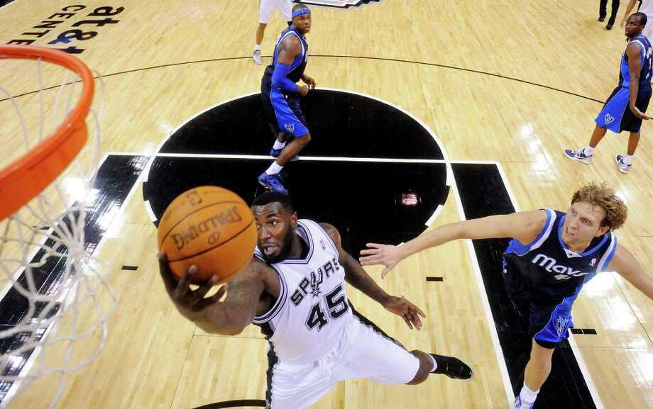 San Antonio Spurs' DeJuan Blair goes up for a rebound around Dallas Mavericks' Dirk Nowitzki during second half action Thursday Jan. 5, 2012 at the AT&T Center.  The Spurs won 93-71. Photo: EDWARD A. ORNELAS, Express-News / SAN ANTONIO EXPRESS-NEWS (NFS)