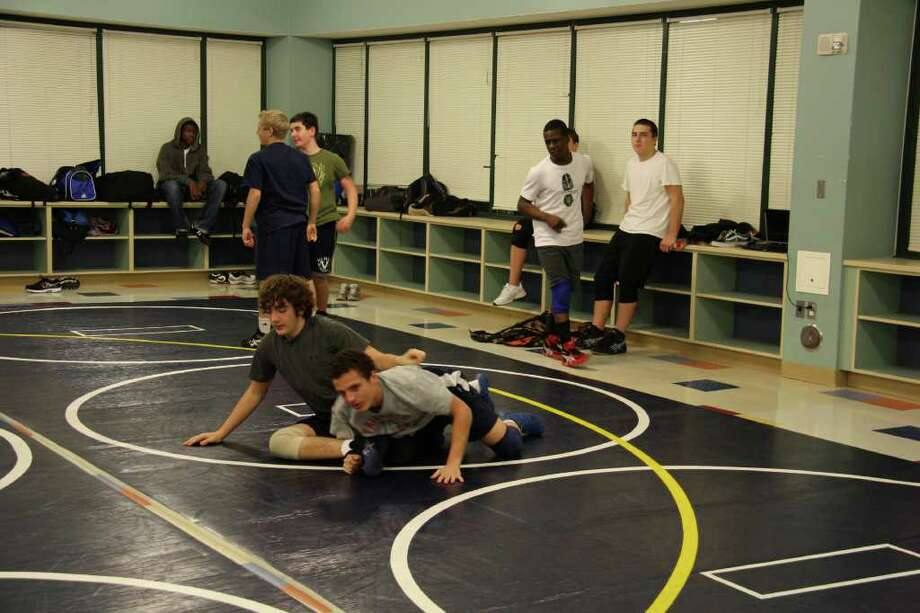 The Staples wrestling team prepare for a preseason practice. Staples opened the season at 2-6 despite a few injuries. Photo: Justine Seligson / For The Westp