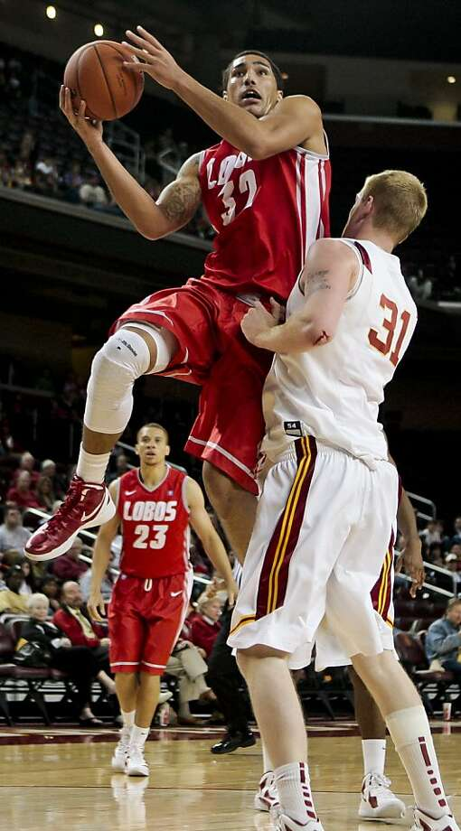 New Mexico forward Drew Gordon takes the ball to the basket around Southern California center James Blasczyk during the first half of an NCAA college basketball game, Saturday, Dec. 10, 2011, in Los Angeles. (AP Photo/Bret Hartman) Photo: Bret Hartman, Associated Press
