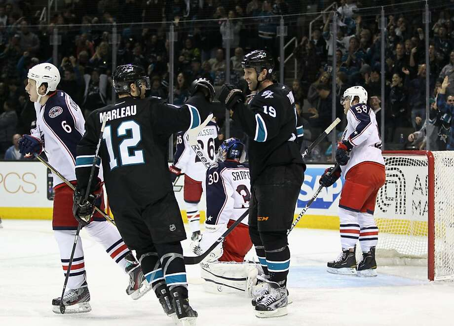 SAN JOSE, CA - JANUARY 05:  Joe Thornton #19 is congratulated by Patrick Marleau #12 of the San Jose Sharks after he scored a goal against the Columbus Blue Jackets at HP Pavilion at San Jose on January 5, 2012 in San Jose, California.  (Photo by Ezra Shaw/Getty Images) Photo: Ezra Shaw, Getty Images