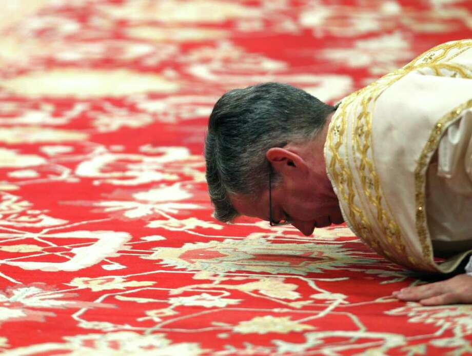 Newly elected US bishop Charles John Brown lays during his ordaining ceremony led by Pope Benedict XVI in St. Peter' s Basilica at the Vatican, Friday, Jan.  6, 2012. (AP Photo/Pier Paolo Cito) Photo: Pier Paolo Cito, Associated Press / AP