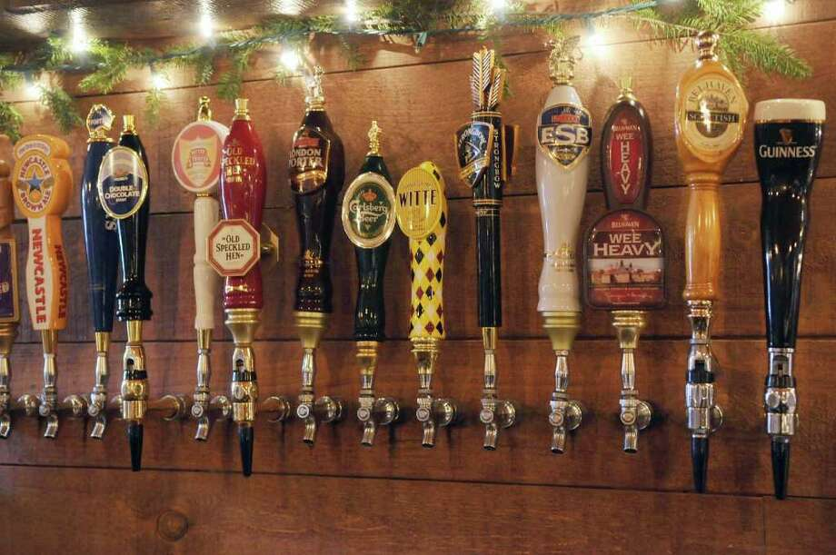 Beer taps line the wall behind the bar at  the  Olde English Pub and Pantry in downtown Albany on Monday, Jan. 2, 2012.   (Paul Buckowski / Times Union) Photo: Paul Buckowski