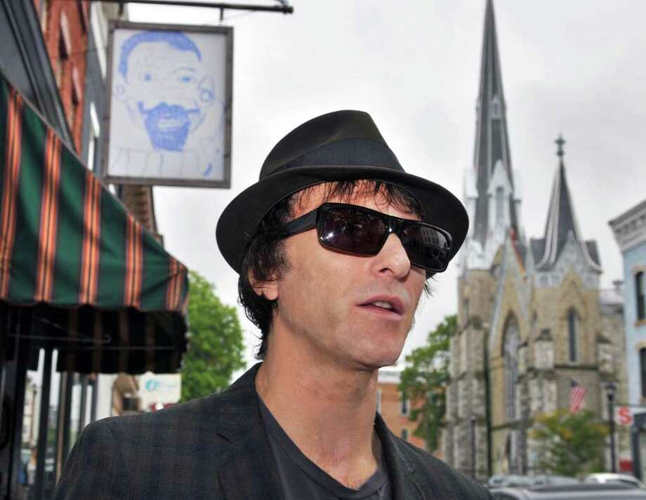 Tommy Stinson, a new resident of Hudson and former bassist in The Replacements, takes a stroll along Warren Street in Hudson this past September (Friday Sept. 23, 2011) before hitting the road on his latest assignment.  Stinson is now playing with Guns n Roses on its worldwide tour.   (John Carl D'Annibale / Times Union) Photo: John Carl D'Annibale / 00014731A