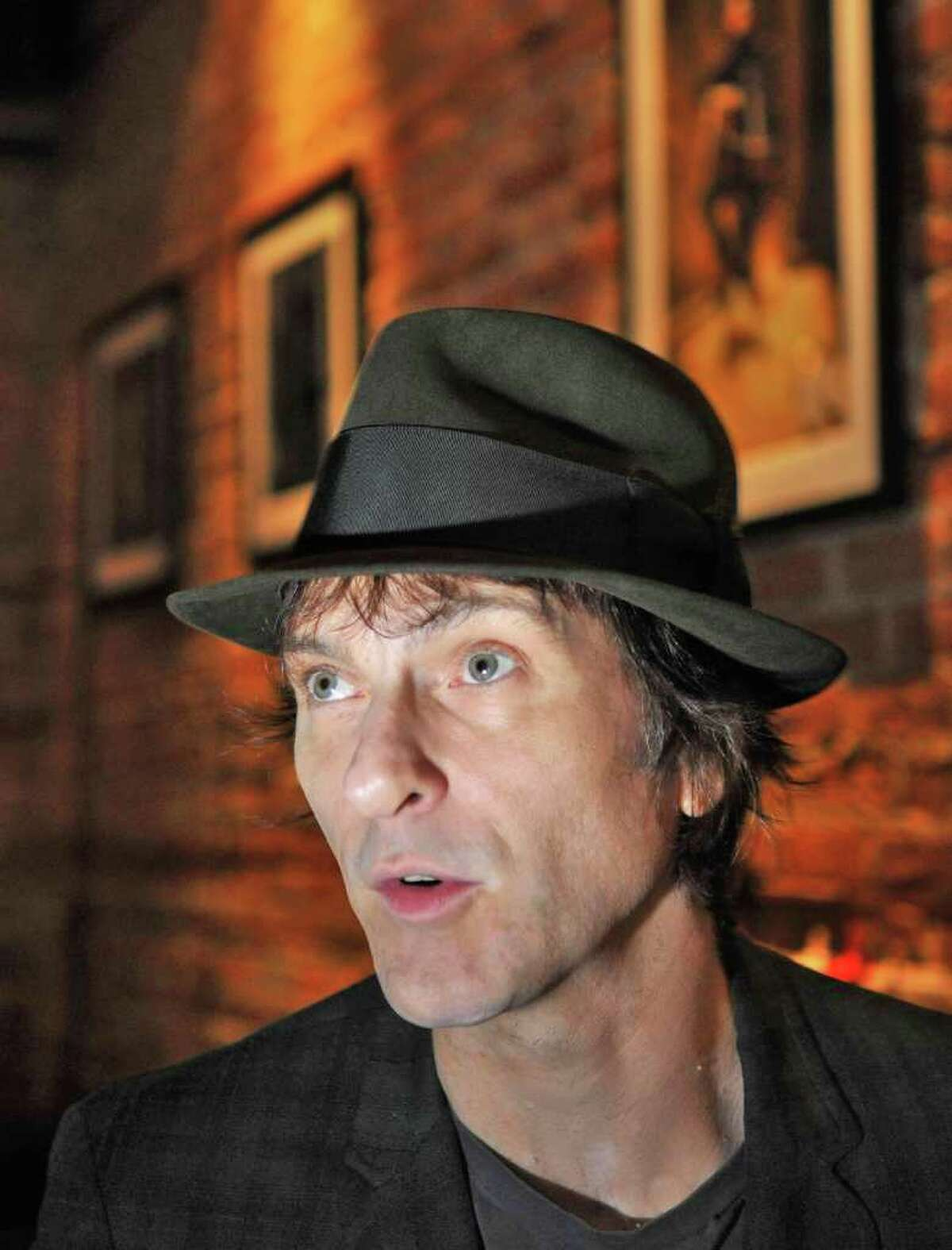Tommy Stinson, a new resident of Hudson and former bassist in The Replacements, sits inside a Warren Street restaurant in Hudson in late September shortly before hitting the road on his latest assignment. Stinson is now playing with Guns n Roses on its worldwide tour. (John Carl D'Annibale / Times Union)