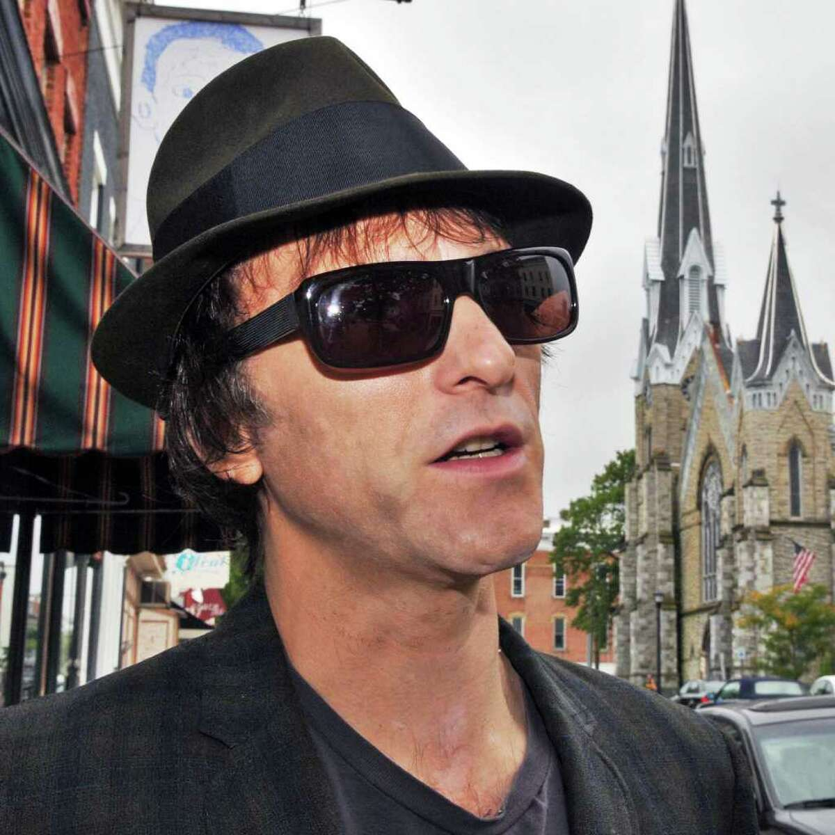 Tommy Stinson, a new resident of Hudson and former bassist in The Replacements, takes a stroll along Warren Street in Hudson this past September (Friday Sept. 23, 2011) before hitting the road on his latest assignment. Stinson is now playing with Guns n Roses on its worldwide tour. (John Carl D'Annibale / Times Union)