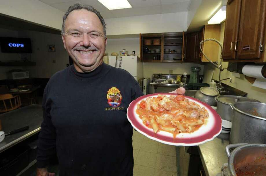 "Fire house chef and Rescue Squad member Lt. Don Urbano, shows off ""shut up and eat it""  the Arbor Hill Fire Station in Albany, N.Y. November 7, 2011.      (Skip Dickstein/Times Union) Photo: Skip Dickstein / 00015113A"