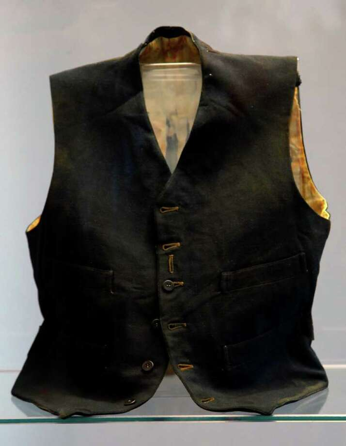 The vest belonging to a third class passenger named William Henry Allen found in the Titanic wreckage is among a sampling of Titanic artifacts on preview Thursday, Jan. 5, 2012 in New York. The complete collection of artifacts recovered from the wreck site of the RMS Titanic will be auctioned by Guernsey's Auction House in April. Photo: Bebeto Matthews, AP / AP