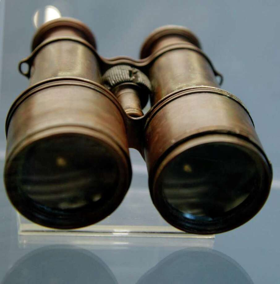 Binoculars found among the debris of the Titanic wreck are previewed among a sampling of Titanic artifacts on Thursday, Jan. 5, 2012 in New York. The complete collection of artifacts recovered from the wreck site of the RMS Titanic will be auctioned by Guernsey's Auction House in April. Photo: Bebeto Matthews, AP / AP
