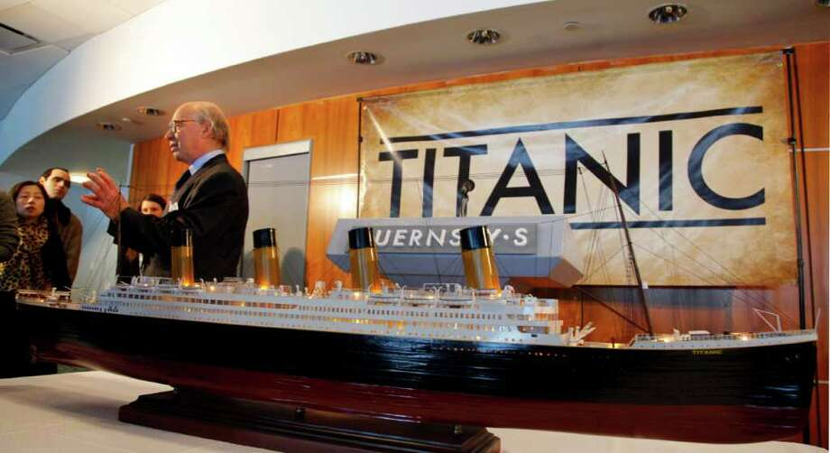 Arlan Ettinger, president of Guernsey's Auction House, stands next to a model of the Titanic, during a press conference and preview of Titanic artifacts on Thursday, Jan. 5, 2012 in New York.  The complete collection of artifacts recovered from the wreck site of the RMS Titanic will be auctioned by Guernsey's Auction House in April. Photo: Bebeto Matthews, AP / AP