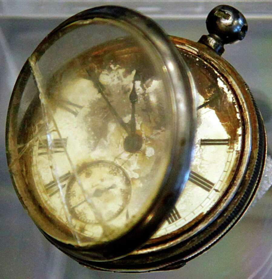 A pocket watch found in the belongings of a third class passenger named William Henry Allen, found in the Titanic wreckage, is among a sampling of Titanic artifacts on preview Thursday, Jan. 5, 2012 in New York. The complete collection of artifacts recovered from the wreck site of the RMS Titanic will be auctioned by Guernsey's Auction House in April. Photo: Bebeto Matthews, AP / AP