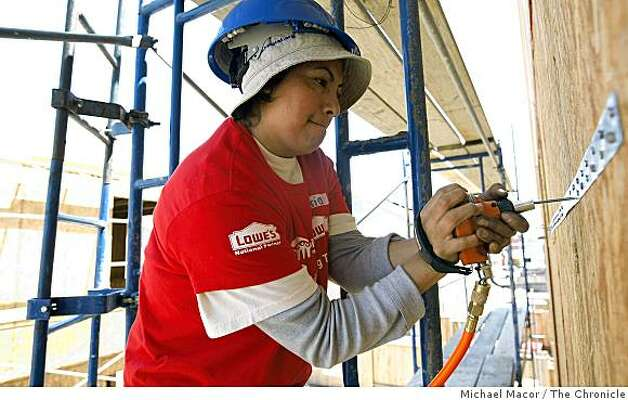 Maria MArtinez, working on the home she will live in when completed, joins a group of women, mostly mothers and daughters, are helping to construct a building in Oakland, Calif. on Saturday May 9, 2009, for Habitat for Humanity. Photo: Michael Macor, The Chronicle