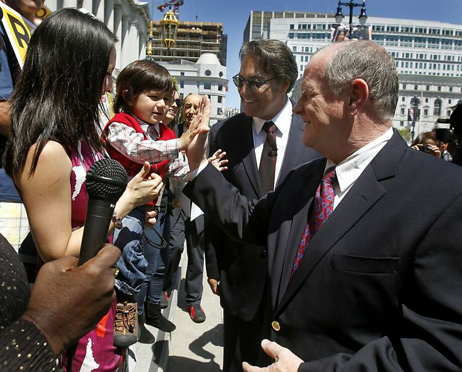 Sheriff Mike Hennessey (right) greets Supervisor Ross Mirkarimi, his wife Eliana Lopez, and son Theo Mirkarimi before endorsing Mirkarimi in his candidacy for Sheriff in San Francisco, Calif. on Tuesday, May 3, 2011. Photo: Paul Chinn, The Chronicle