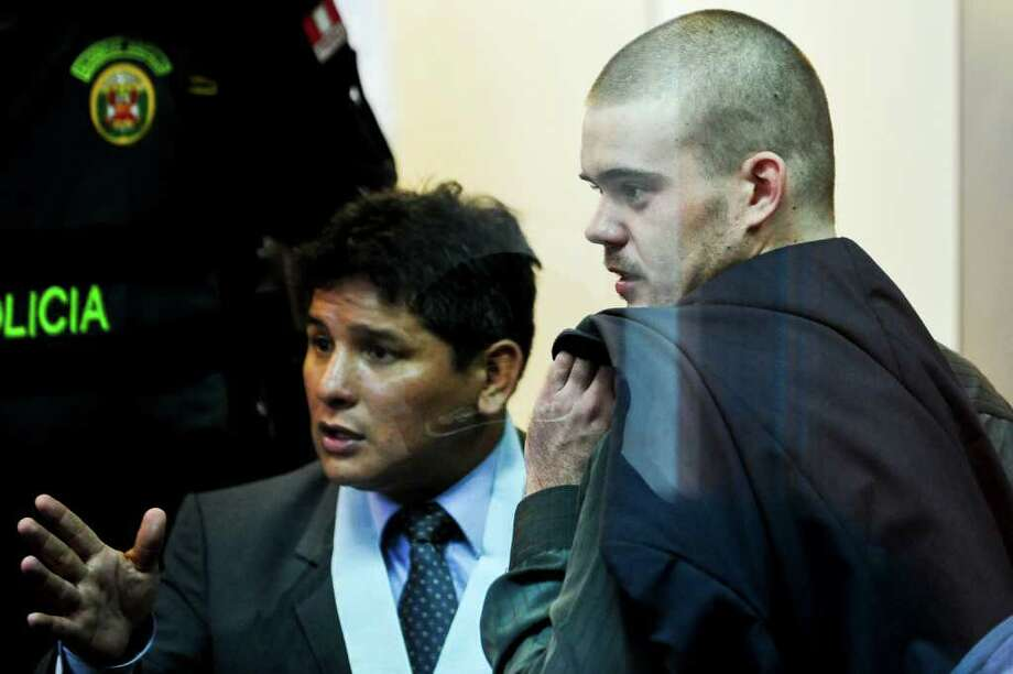 Jose Luis Jimenez (L) , lawyer of Dutch national Joran Van der Sloot (R), speaks during the preliminary hearing in court in the Lurigancho prison in Lima on January 6, 2011.  Trial gets in Lima for Van der Sloot, accused of killing Flores in 2010 and who also is a suspect in the disappearance years earlier of an American woman in the Caribbean. AFP PHOTO/ Ernesto Benavides Photo: ERNESTO BENAVIDES, AFP/Getty Images / AFP